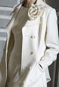 Beautiful Carolina Herrera winter white coatdress with flower applique