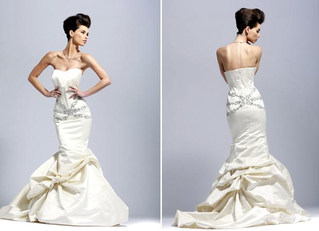 Stunning, sexy ivory strapless wedding dress with modified sweetheart neckline and silver details