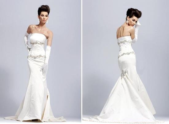 White strapless mermaid silhouette wedding dress, with silver embellishments