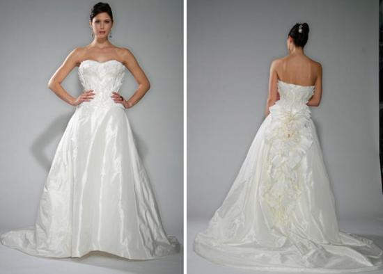Dramatic Gilles Montezin wedding dress with strapless neckline, ruffled detail on bodice, and full a