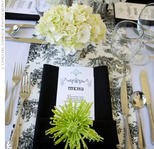 Beautiful black, white, ivory and green tablescape with lime green flower atop black napkin