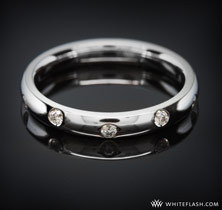 This platinum wedding band from Whiteflash.com has scattered inset diamonds.