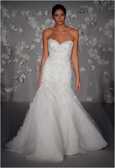 Ivory hand beaded wedding dress with a tulle trumpet skirt and sweetheart neckline