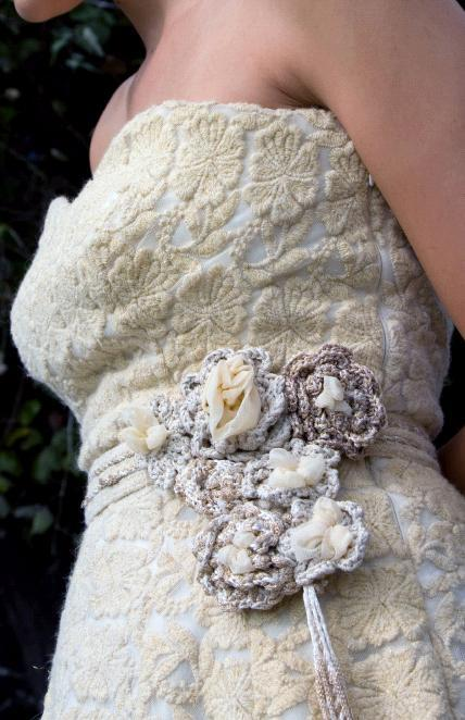 Beautiful wedding dress details- rope flower applique at waist