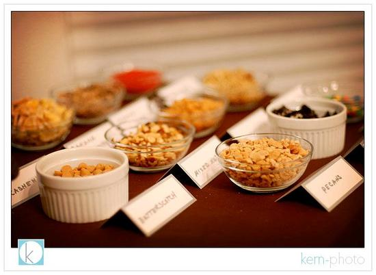 Carmel apple bar at your wedding- nuts, crushed up candy, chocolate chips and more!