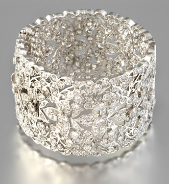 Statement making silver and diamond cuff bracelet from Tejani, with a beautiful floral design