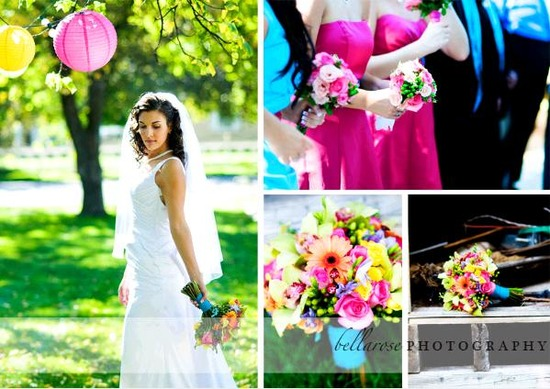 Beautiful bride poses outside with colorful bridal bouquet; bridesmaids in pink dresses stand at alt