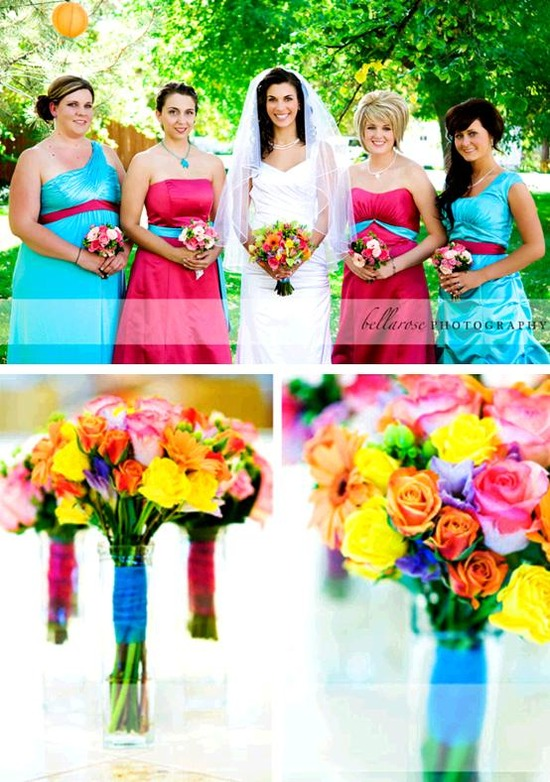 Beautiful bride in white Maggie Sottero wedding dress, bridesmaids in teal and hot pink bridesmaids'