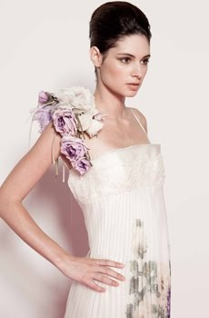 Sheath style ivory wedding dress with oversized flower applique on one shoulder
