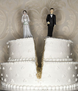This divorce cake is a traditional white two-tiered wedding cake split in half