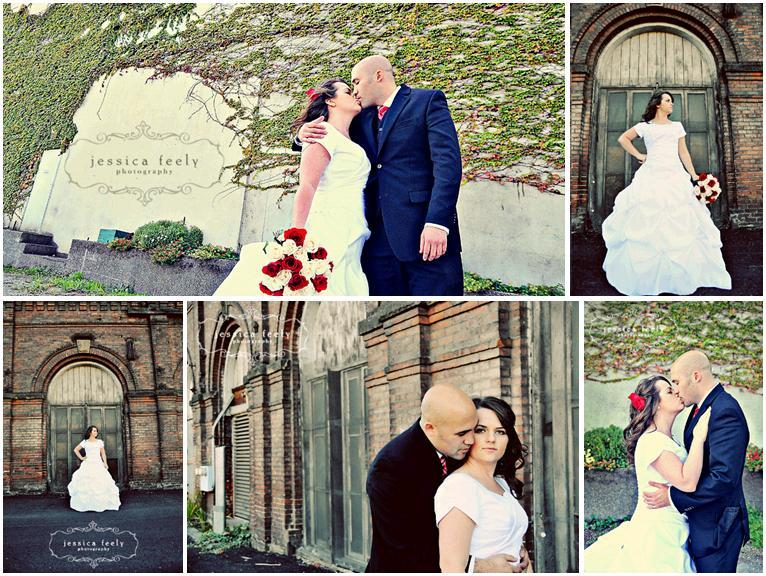 Red-ivory-white-roses-bridal-bouquet-red-flower-in-hair-groom-in-navy-suit-red-tie-ivy-brick-wall.full