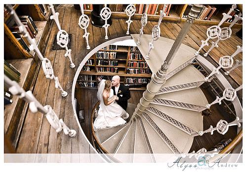 Romantic-wedding-photography-bride-groom-kiss-on-spiral-staircase-in-library.full