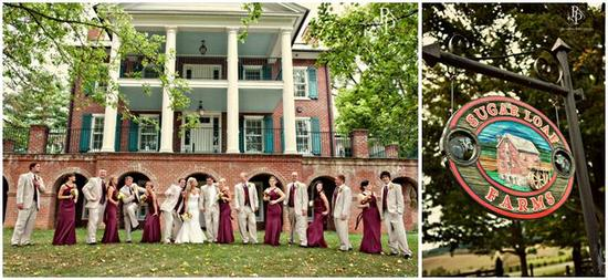 Bridesmaids in maroon bridesmaids' dresses, groomsmen in khaki suits, pose together in front of plan