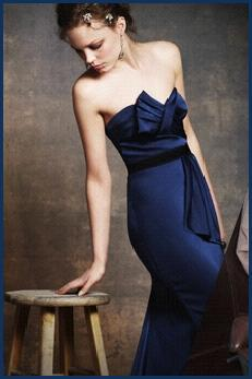 Beautiful BCBG midnight blue strapless evening gown with bow detail at bust