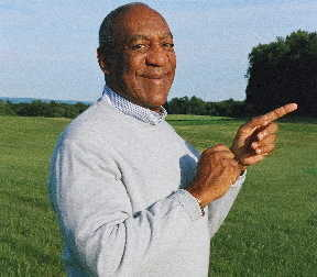 Comedian Bill Cosby stands outside.