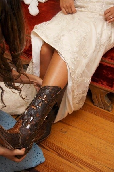 Fabulous brown leather cowboy boots adorned with rhinestones, paired with a beautiful ivory wedding