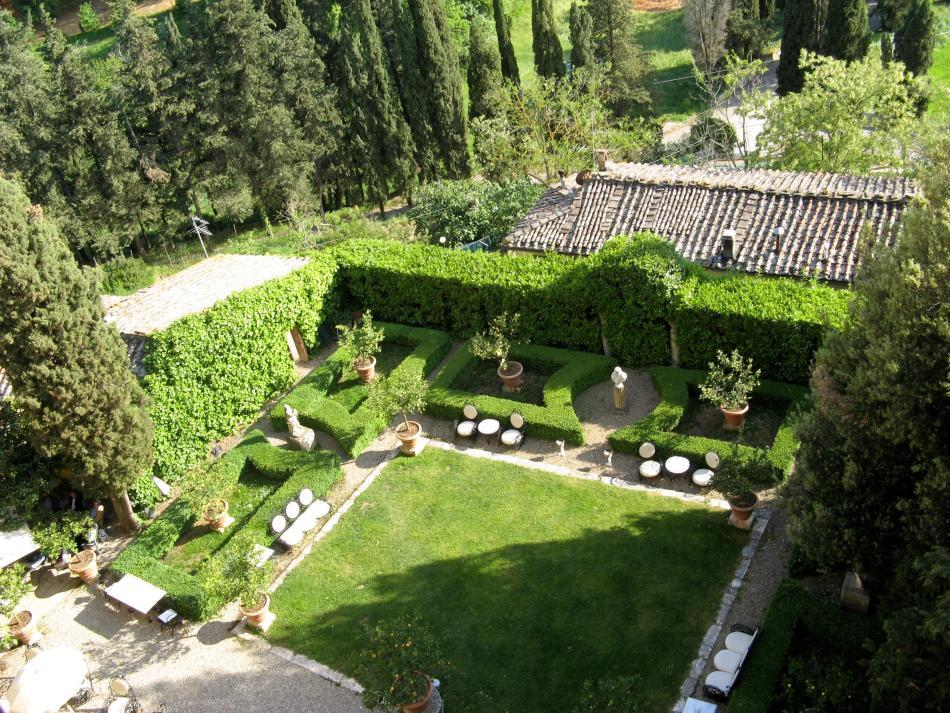 The beautiful La Suvera in Sienna, Italy- top view of the garden, with wild birds and exotic animals