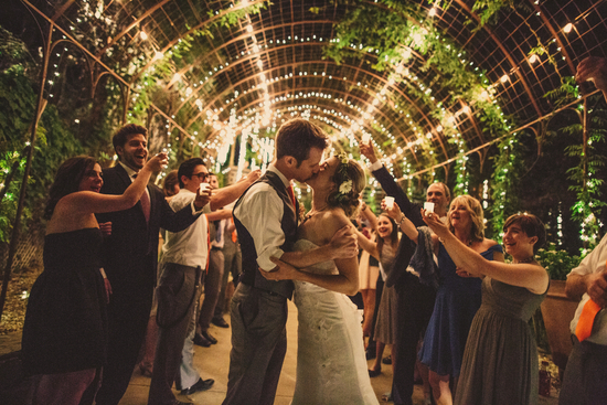 Bride and Groom Kiss Under Stunning Lights
