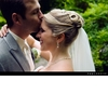 Kwp-groom-lovingly-kisses-brides-forehead-grey-tux-ivory-tie-white-veil.square