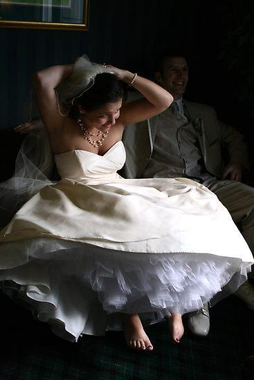 Barefoot bride with white strapless sweetheart wedding dress
