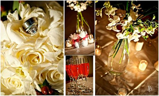Beautiful cream roses with diamond wedding rings on top; red signature drinks in champagne flutes