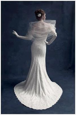 Traditional white wedding dress, long gloves, tulle wrap on shoulders
