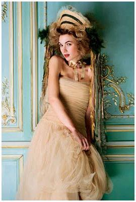Neil-cunningham-gold-tan-strapless-tulle-dress-teal-gold-background-oversized-bridal-headpiece.full
