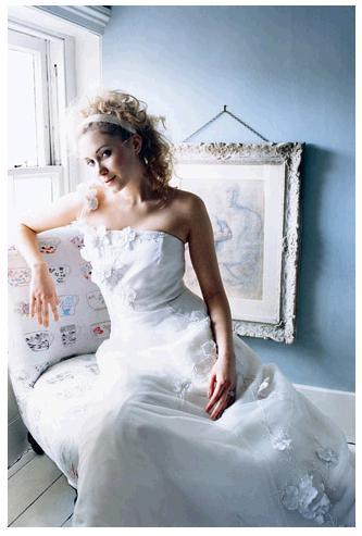 White wedding dress, florals applied to a tulle skirt and bodice