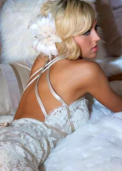 Gorgeous white, backless lace Amy Michelson wedding dress, oversized white feather flower in hair