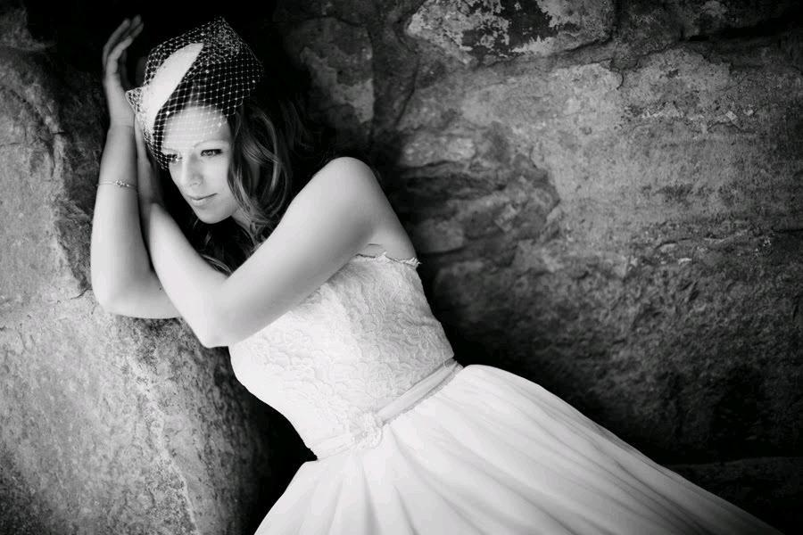 Stunning black and white photo of bride in white strapless chantilly lace wedding dress and birdcage