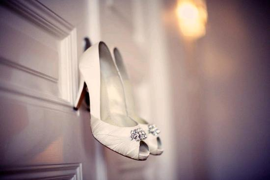 Gorgeous ivory satin peep toe bridal heels with crystal brooch