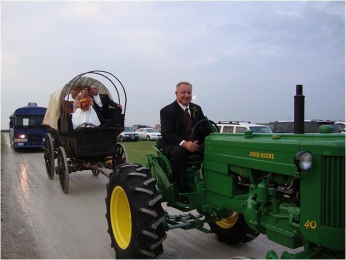 and groom ride to wedding reception on John Deere tractors