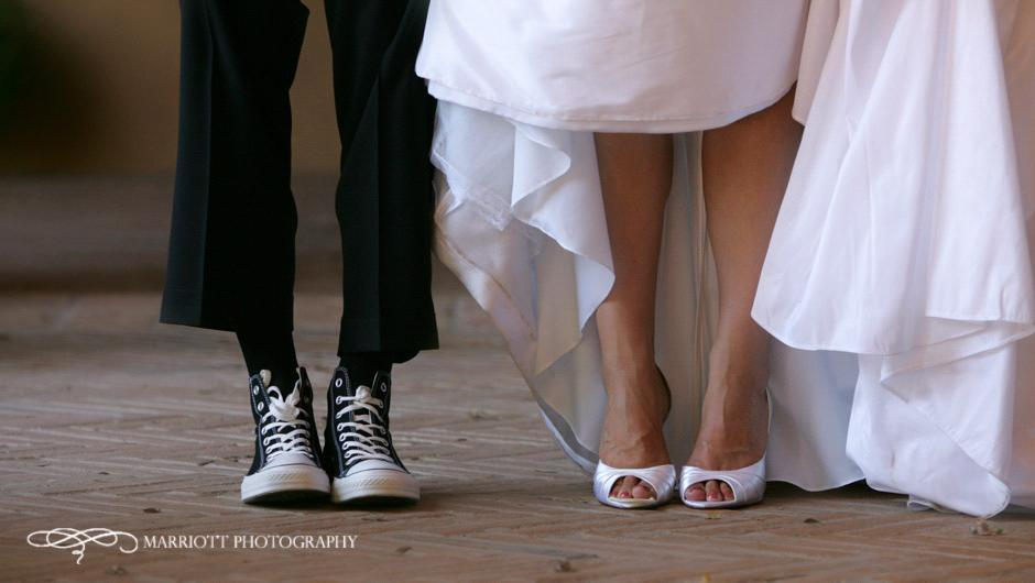Bride In White Wedding Dress And P Toe Bridal Shoes Groom Black Converse All Stars
