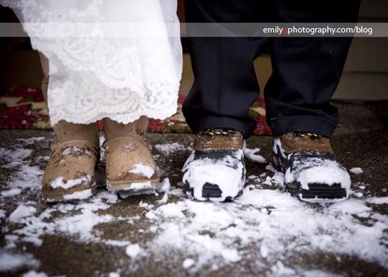 Bride and groom have winter wedding, wear snow boots with wedding dress and tux