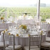 The white tablecloths and yellow flowers make this a perfect daytime reception site.
