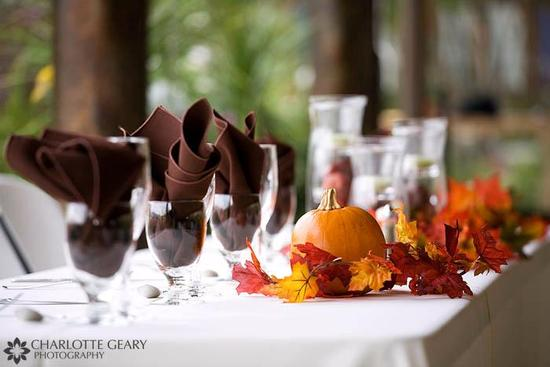 Use pumkins of all sizes as centerpieces for the tablescapes at your wedding