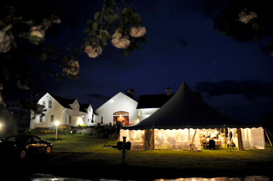 A tent provides the perfect location for an elegant, but fun, outdoor nighttime reception.