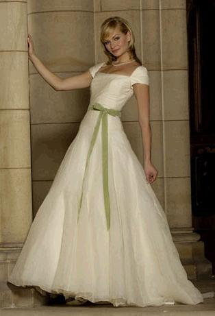 Sweet and romantica ivory wedding dress, off-the-shoulder, full skirt, sage bow