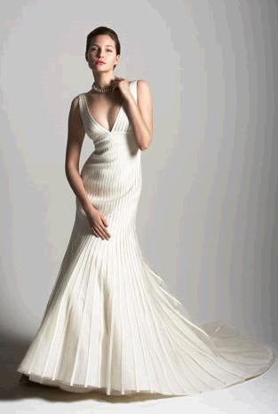 Stunning and dramatic deep-v wedding dress with trumpet skirt