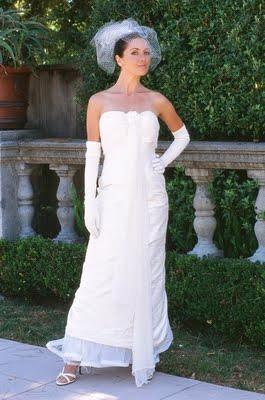 Beautiful white strapless wedding dress with vertical sash to the floor, by Amy-Jo Tatum