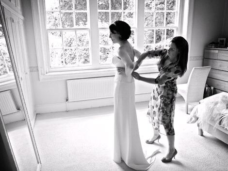 The-final-fitting-wedding-dress-photographer-captures-moment-black-white-photo-bridesmaid-zippers-dress.full