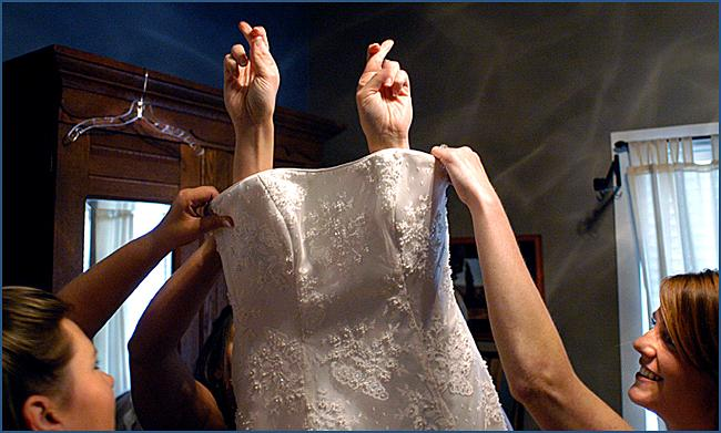 The-final-fitting-wedding-dress-photographers-capture-bride-getting-into-dress-before-walking-down-aisle-bride-crosses-fingers.original