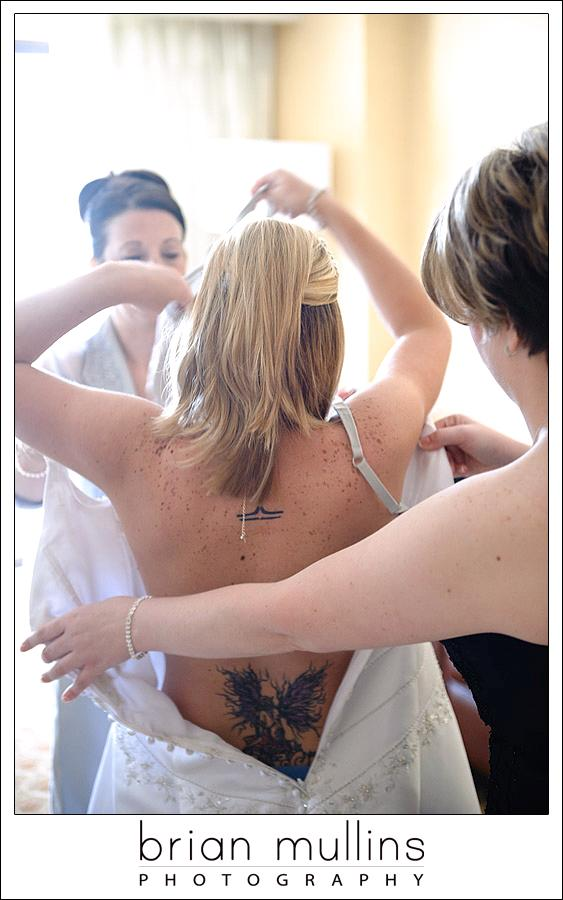 The-final-fitting-wedding-dress-photographers-capture-bride-getting-into-dress-before-walking-down-aisle.original