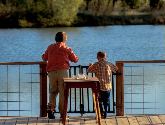 Young guests enjoy time on dock of the spring-fed 2.5-acre pond at the Civil War Ranch in Carthage, MO. Photo by George Datum