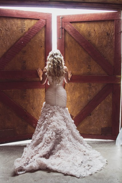 Bride at doors of Wedding Barn at the Civil War Ranch. Photo by Funky Diva