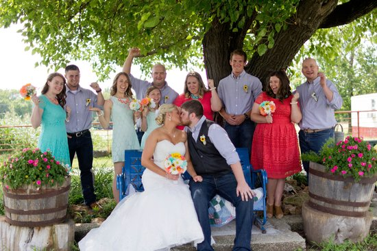 Kati and Ryan with their entourage under the Wedding Tree at the west end of the Barn Courtyard. Photo by Captured By Cory Photography