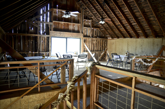 View from second-floor landing looking northwest in the Wedding Barn at Civil War Ranch in Carthage, MO. Photo by Funky Diva Photography