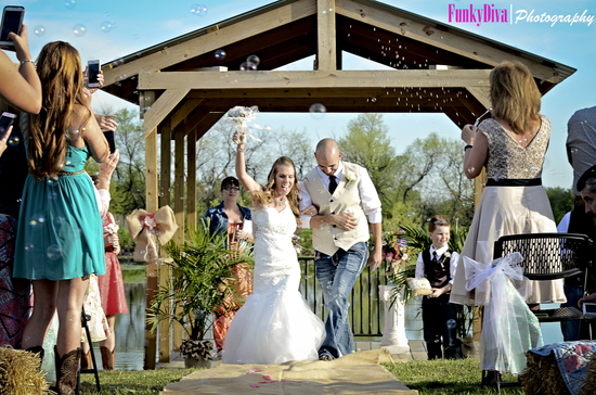 Ashlea and Matt after their wedding ceremony on the dock of the Ranch Pond at the Civil War Ranch in Carthage, MO. Photo by Funky Diva Photography