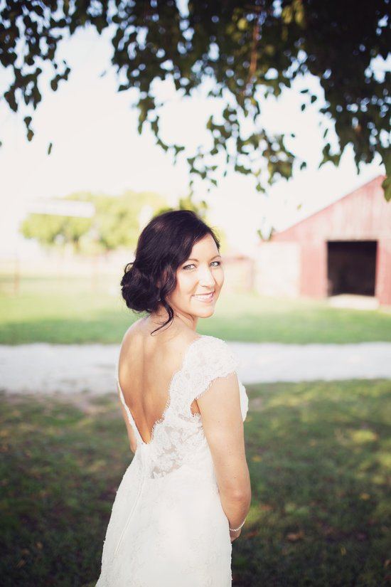 Bride Katelyn under the Wedding Tree in Civil War Ranch Courtyard. Photo by Sweet Tea Photography