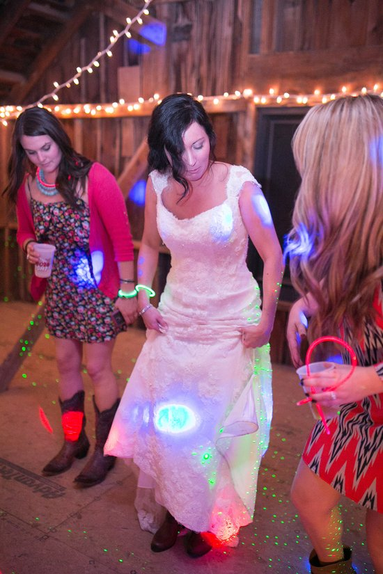 Bride joins the dancing in the Wedding Barn at Civil War Ranch. Photo by Sweet Tea Photography